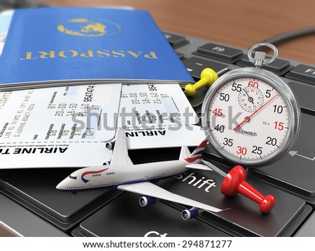 Travel concept. Passports, airline tickets, stopwatch and airplane on the keyboard. Fast order air tickets. - stock photo