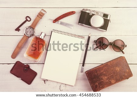 travel concept - set of cool stuff with camera and other things on wooden table - stock photo