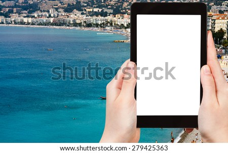 travel concept - tourist photograph Azure coast in Nice city, France on tablet pc with cut out screen with blank place for advertising logo  - stock photo