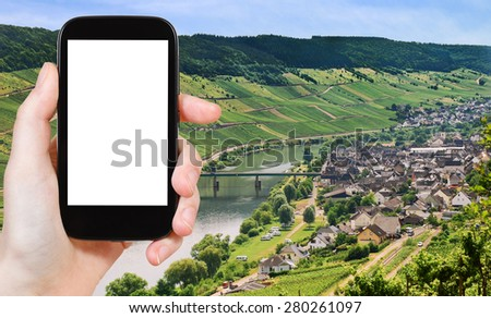 travel concept - tourist photograph Town Zell and Moselle river, Germany in summer day on tablet pc with cut out screen with blank place for advertising logo - stock photo