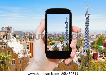 travel concept - tourist taking photo of Barcelona landscape on mobile gadget, Spain - stock photo
