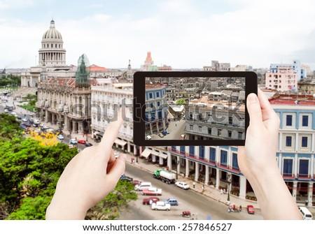 travel concept - tourist taking photo of center Havana city on mobile gadget, Cuba - stock photo