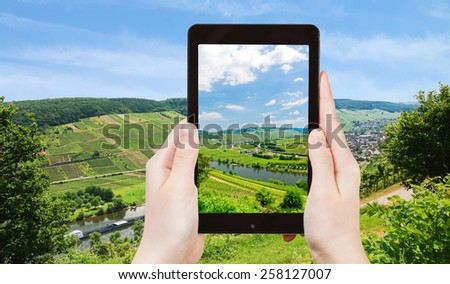 travel concept - tourist taking photo of Moselle valley and Mosel river in summer day, Germany on mobile gadget - stock photo