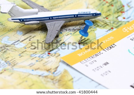 Travel conceptual - a plane flying over India map with boarding pass. - stock photo