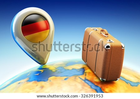 Travel destination and global tourism concept, pin pointer marker with Germany national flag and brown leather suitcase on Earth globe (Elements of this image furnished by NASA) - stock photo