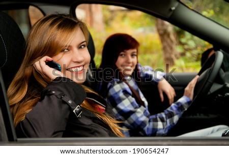 travel, girl friends sitting in the car - stock photo