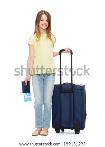 travel, holiday, vacation, childhood and transportation concept - smiling little girl with suitcase, airplane ticket and passport - stock photo