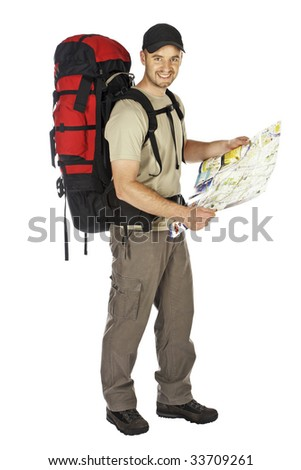 travel image of young caucasian man with big backpack and map in his hands - stock photo