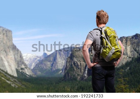 Travel in Yosemite Park, man Hiker with backpack enjoying view, California, USA, caucasian - stock photo