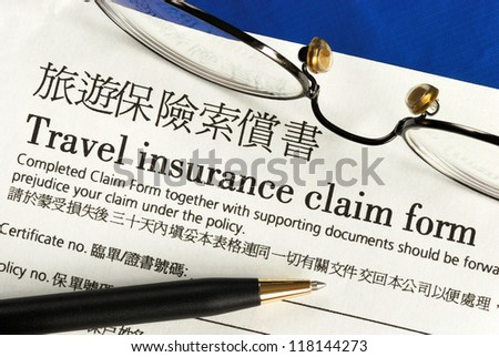 Travel insurance claim form in both English and Chinese - stock photo