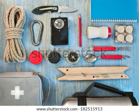 travel kit modern traveler scout on blue backpacking - stock photo