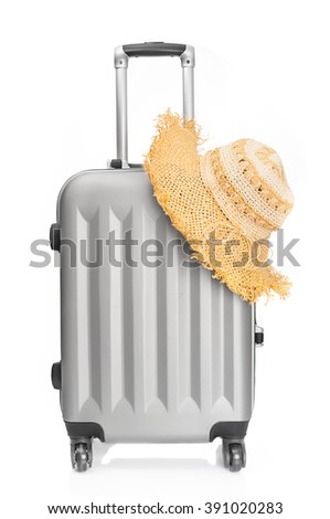 Travel luggage and straw hat on white background - stock photo
