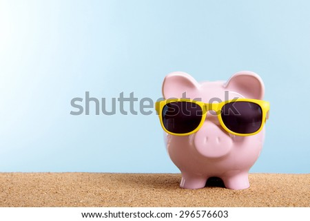 Travel money concept, summer vacation savings, piggy bank sunglasses.  Copy space. - stock photo
