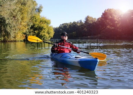 Travel on the river in a kayak on a sunny day. - stock photo
