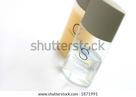 travel pack of shampoo and conditioner - stock photo