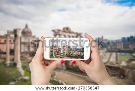 Travel photo on the phone. Roman Forum in Rome, Italy - stock photo