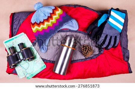 Travel set. Tourist outfit for camping on a sleeping bag. - stock photo