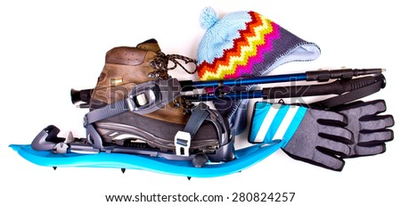 Travel set with snowshoes. Tourist outfit for winter camping or hiking. Various professional tools and items for outdoors pastime on white background. Partly isolated with shadows. - stock photo