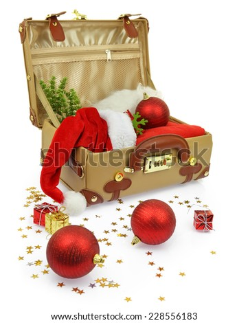 Travel suitcase with Christmas ornaments isolated on white - stock photo
