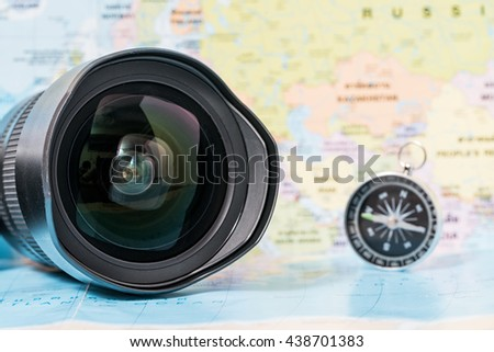 Travel the world through the lens opening - stock photo