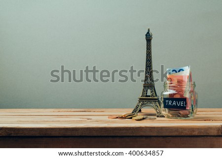 Travel to Paris, France concept with Eiffel Tower souvenir. Planning summer vacation, money budget trip concept. - stock photo