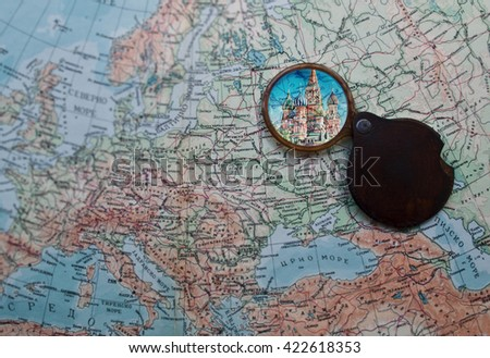 Travel to Rome, Italy - Vintage map with magnifying glass over Moscow, Russia - stock photo