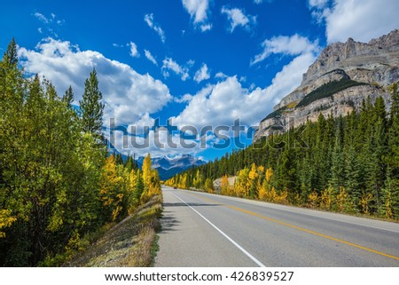 Travel to the Bow River Canyon in September. Excellent highway and surrounded by autumnal woods. Canadian Rockies, Great Banff - stock photo
