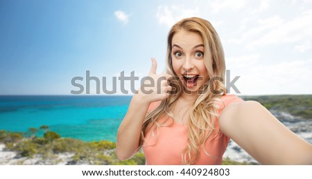 travel, tourism, emotions, expressions and people concept - happy smiling young woman taking selfie and showing thumbs up over exotic tropical beach background - stock photo