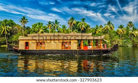 Travel tourism Kerala background - panorama of tourist houseboat on Kerala backwaters. Kerala, India - stock photo