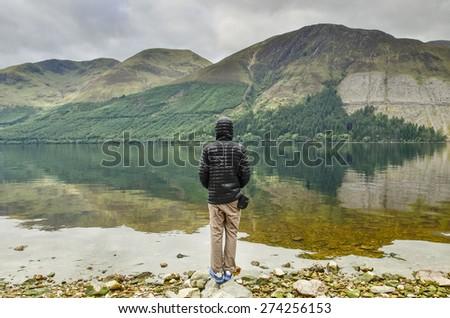 traveler in Highlands,Scotland - stock photo