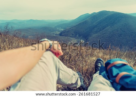 Traveler man resting in the mountains. Point of view shot. Focus on nature - stock photo