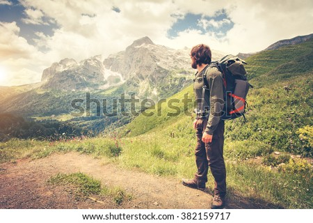 Traveler Man with backpack hiking Travel Lifestyle concept mountains on background Summer journey adventure vacations outdoor - stock photo