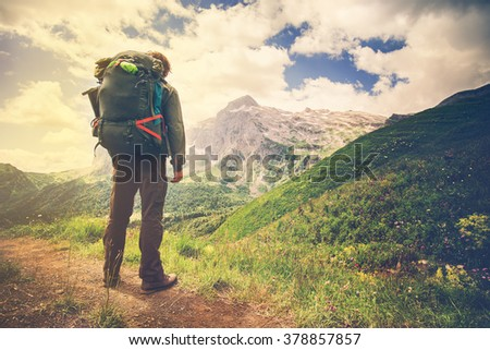 Traveler Man with backpack hiking Travel Lifestyle concept mountains on background Summer trip vacations outdoor - stock photo