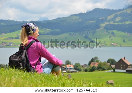 Traveler on the top of the hill - stock photo