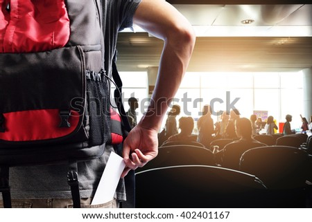 traveler presenting passenger tickets for flight at counter check-in airport - stock photo