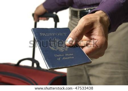 Traveler shows US passport - stock photo