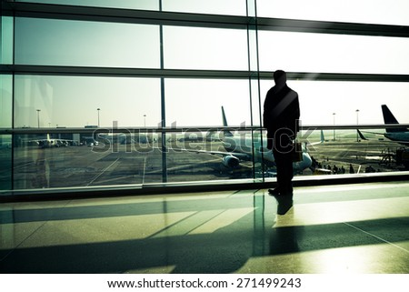 Traveler silhouettes at airport,Dublin - stock photo