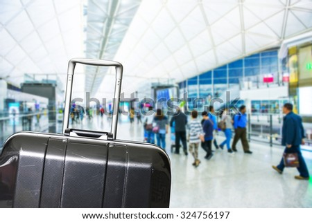 Traveler Suitcases in Airport Terminal Waiting Area - stock photo