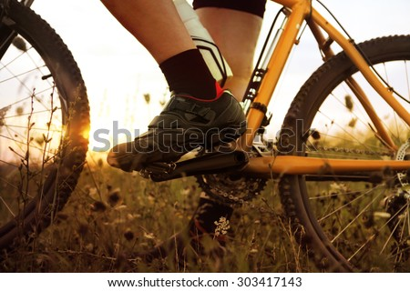 traveler who stopped on field at sunset time - stock photo