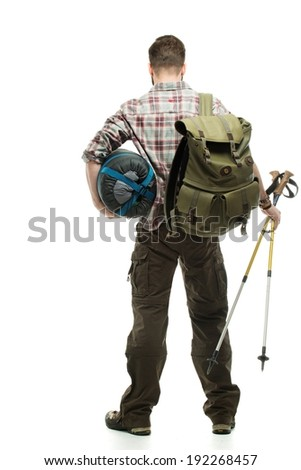 Traveler with backpack, hiking poles and sleeping bag  - stock photo