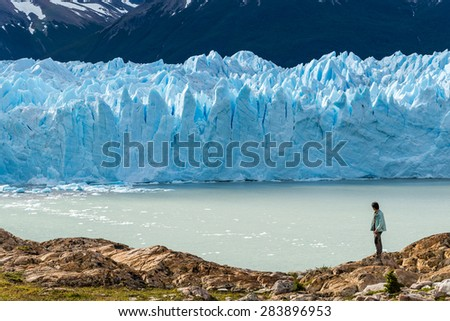 Traveler with Perito Moreno glacier, Argentina - stock photo