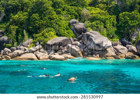 Travelers are swimming and snorkeling in Andaman sea at Similan Island  - stock photo
