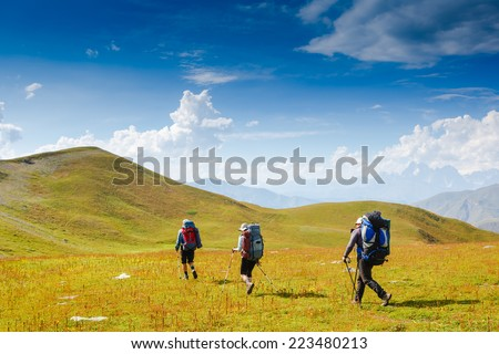 Travelers in the mountains. Sport lifestyle travel concept - stock photo