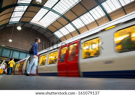 Travelers movement in tube train station, King Cross, London  - stock photo