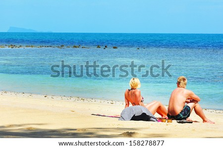 Travelers  relax on the beach ,thailand - stock photo