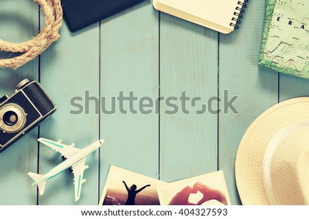 traveling concept. camera, notebook and fedora hut. vintage filtered. top view  - stock photo