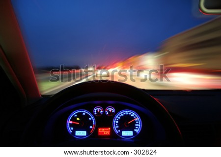 Traveling fast at dusk - stock photo