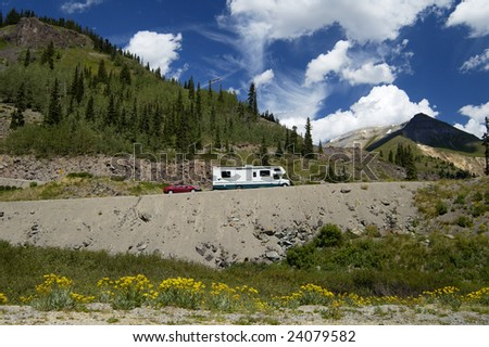 traveling in a recreational vehicle on a mountain road in Colorado - stock photo