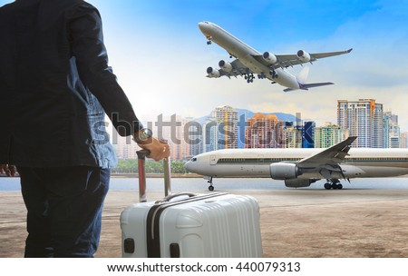 traveling man and luggage at air port - stock photo