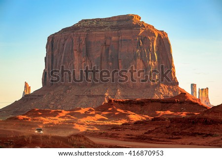 Traveling on a dirt road in Monument Valley, Arizona, USA. - stock photo